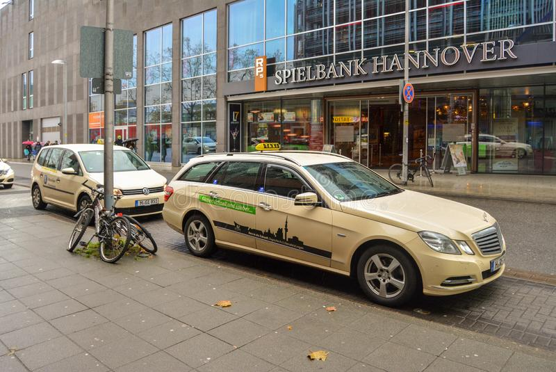Hannover, Germany. 20 nov 2017. The streets of Hannover. Spielbank Hannover office. Taxi car in the foreground royalty free stock images