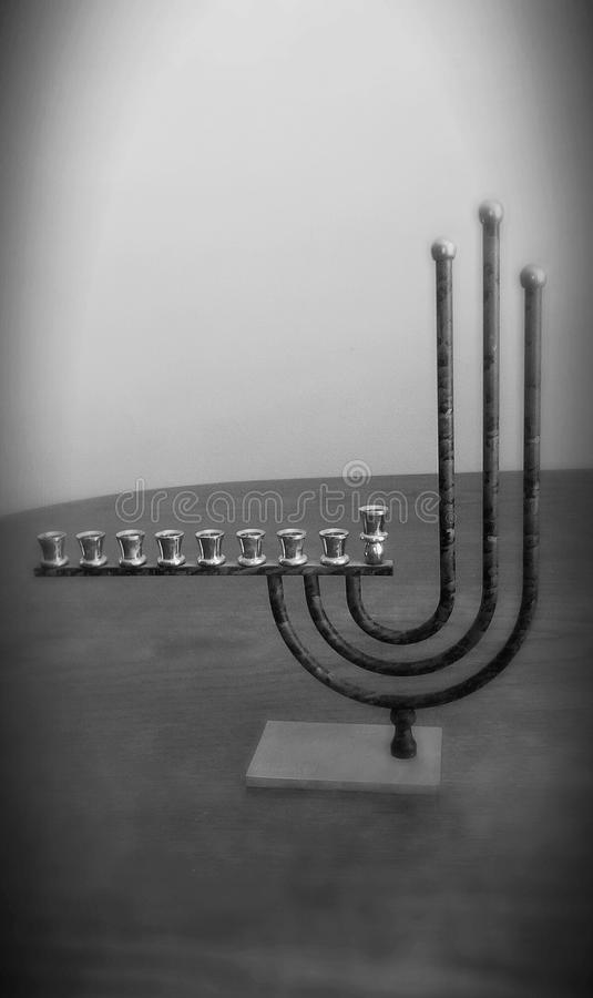 Hanukkah menorah. Hannukah menorah is a candelabra designed specifically for Hanukkah candles and contains room for nine candles .One for each night ,plus the royalty free stock photo