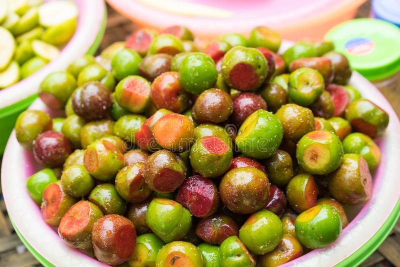 Hanoi street food, pickle fresh plum fruit.  royalty free stock photo