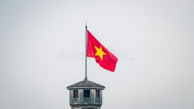 Hanoi Tower National FLag Flying. Vietname South East Asia. Most certainly a main attraction in the area and represents the culture of the locals stock photos