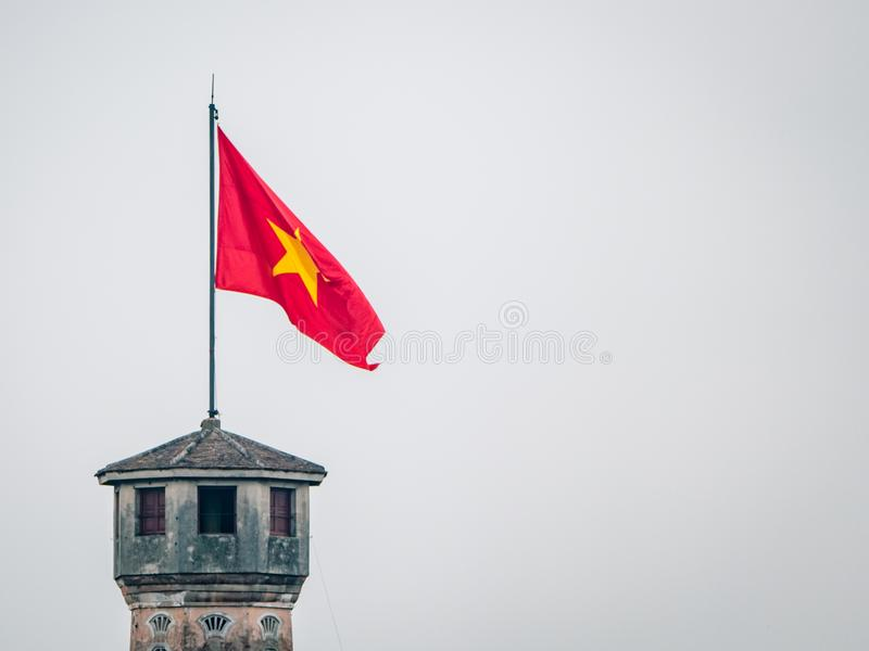 Hanoi Tower National FLag Flying. Vietname South East Asia. Most certainly a main attraction in the area and represents the culture of the locals stock photography
