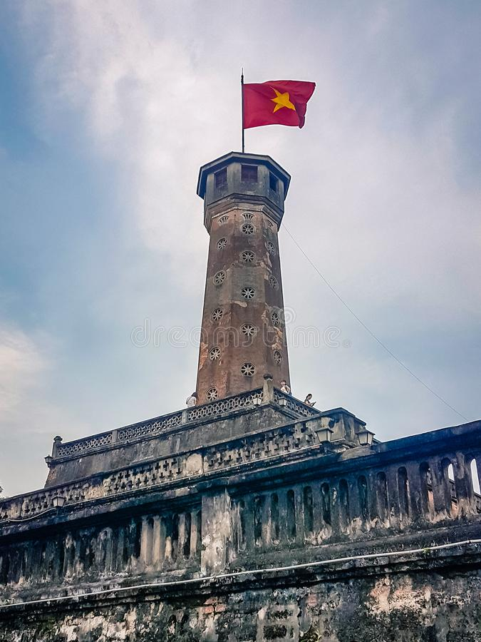 Hanoi Tower National FLag Flying. Vietname South East Asia. Most certainly a main attraction in the area and represents the culture of the locals stock photo