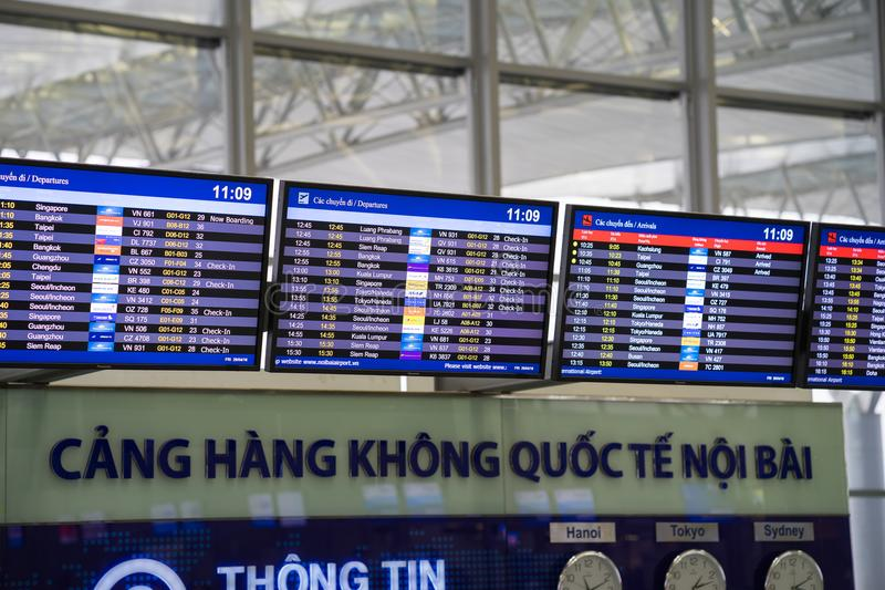Hanoi, Vietnam - Apr 29, 2016: Airport LED display for departure times and destinations at Noi Bai international airport royalty free stock photo