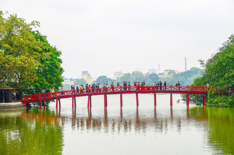 The Huc Bridge or Sun shine bridge at Hoan Kiem Lake, It`s a red wooden arch bridge royalty free stock images