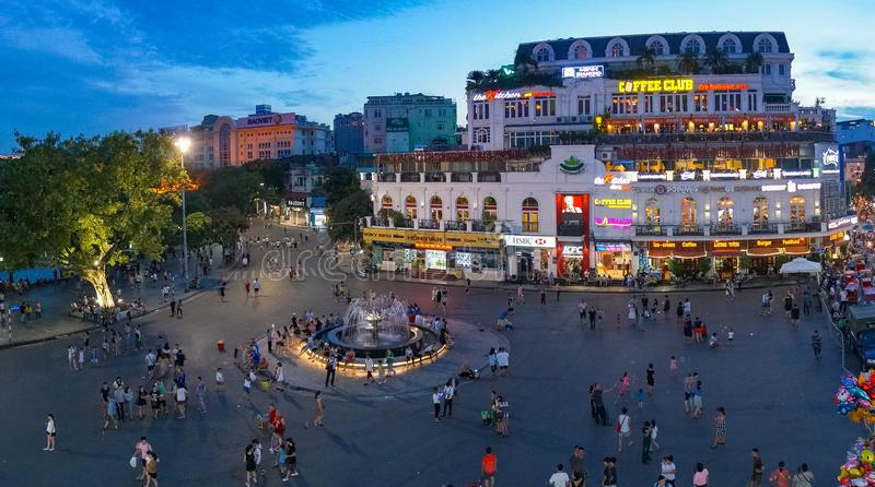 Hanoi city square with fountain with people in the evening royalty free stock photo