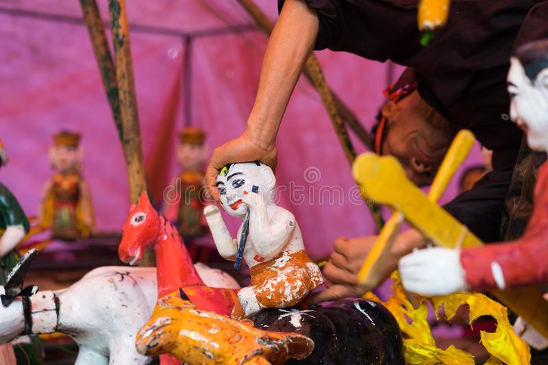 Hanoi, Vietnam - Feb 7, 2015: Common Vietnamese water puppets behind puppetry state at Vietnamese lunar new year festival organize. D at Vinschool, Vinhomes royalty free stock photos