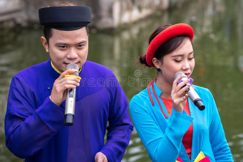 Hanoi, Vietnam - Feb 9, 2017: Folk singers singing Bac Ninh duets, folk singing on the boat in La Phu village, Hoai Duc. Intangibl royalty free stock images