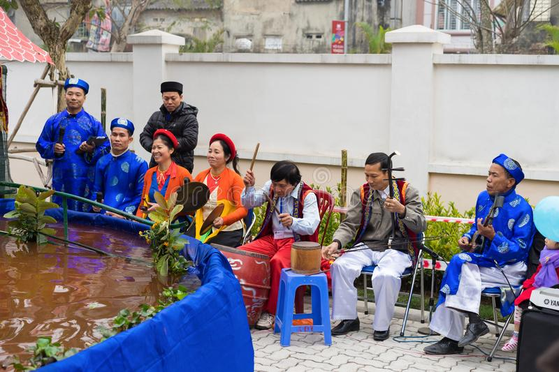 Hanoi, Vietnam - Feb 7, 2015: Group of puppetreers perform a puppetry show at Vietnamese lunar new year festival organized at Vins. Chool, Vinhomes Times City royalty free stock image