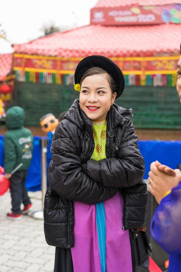 Hanoi, Vietnam - Feb 7, 2015: Portrait of woman Puppetry at break time before next puppetry show at Vietnamese lunar new year fest. Ival organized at Vinschool stock images