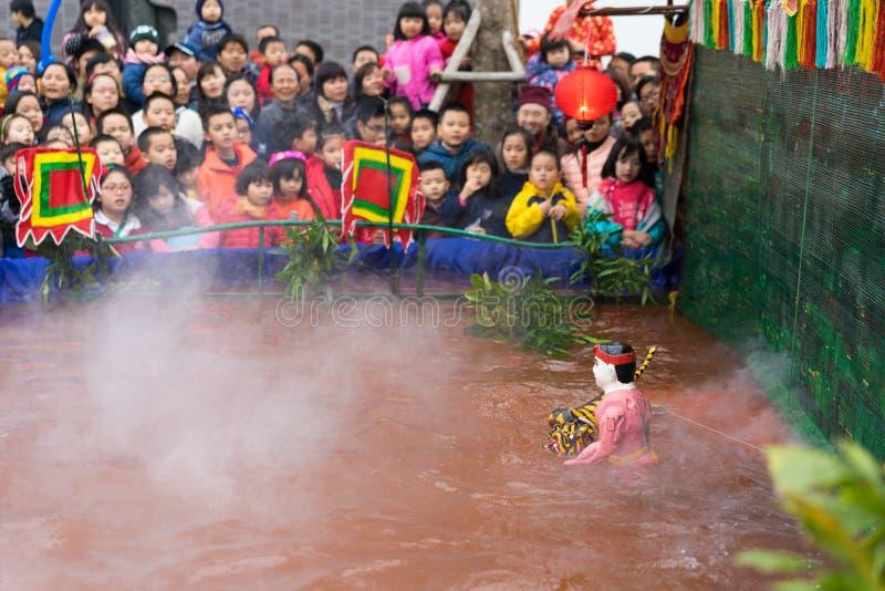 Hanoi, Vietnam - Feb 7, 2015: Puppetry show Hero kills tiger at Vietnamese lunar new year festival organized at Vinschool, Vinhome. S Times City, Minh Khai stock image