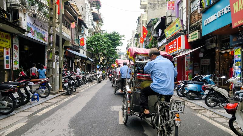 Hanoi - Vietnam. September 01, 2018. busy road with many motorcycles and people . Motorcycle is the most popular mode of transportation in Vietnam stock image