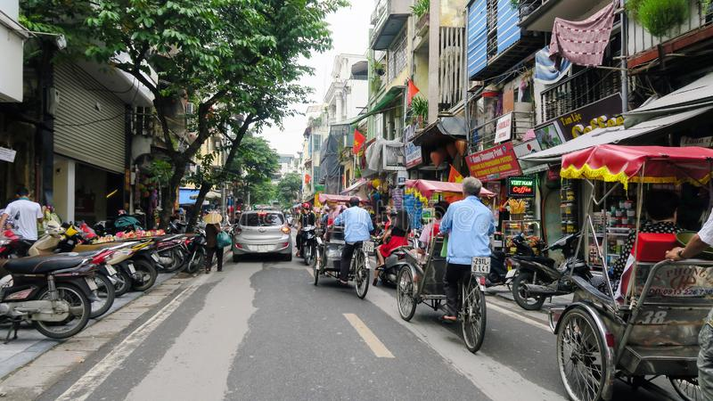 Hanoi - Vietnam. September 01, 2018. busy road with many motorcycles and people . Motorcycle is the most popular mode of transportation in Vietnam royalty free stock photos
