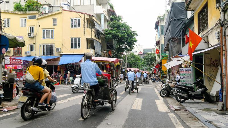 Hanoi - Vietnam. September 01, 2018. busy road with many motorcycles and people . Motorcycle is the most popular mode of transportation in Vietnam royalty free stock photography