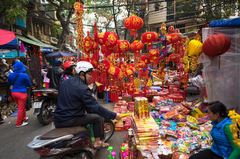 Hanoi, Vietnam - Jan 26, 2017: People take a walk buying decoration and flower for Vietnamese lunar new year on Hang Ma street.  stock images