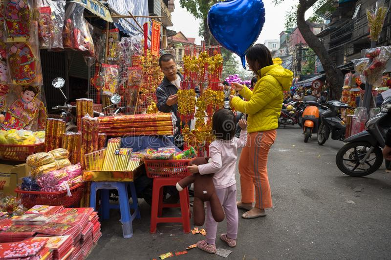 Hanoi, Vietnam - Jan 26, 2017: People take a walk buying decoration and flower for Vietnamese lunar new year on Hang Ma street.  royalty free stock photography