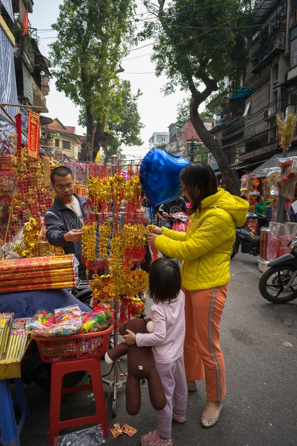 Hanoi, Vietnam - Jan 26, 2017: People take a walk buying decoration and flower for Vietnamese lunar new year on Hang Ma street.  stock image