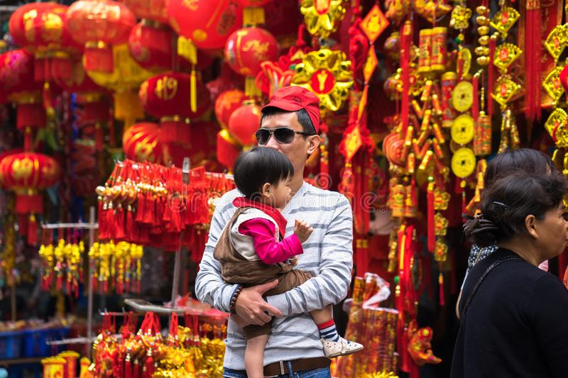 Hanoi, Vietnam - Jan 26, 2017: People take a walk buying decoration and flower for Vietnamese lunar new year on Hang Ma street.  royalty free stock photos