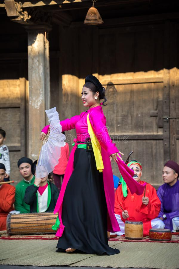 Hanoi, Vietnam - Jun 22, 2017: An act of folk music and dance called Thi Mau visits temple, the most popular act of Cheo in Vietna royalty free stock photo