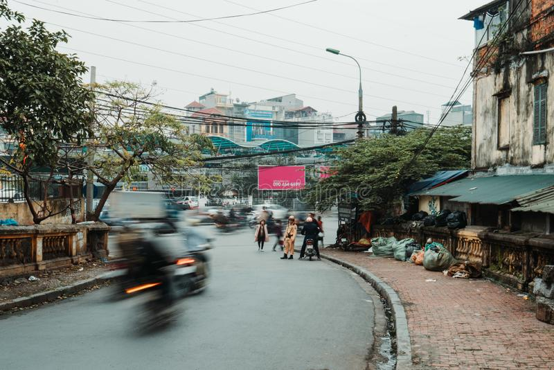 Hanoi, Vietnam, 12.20.18: Life in the street in Hanoi. Policemen try to fine people without a helmet on their scooters. royalty free stock images