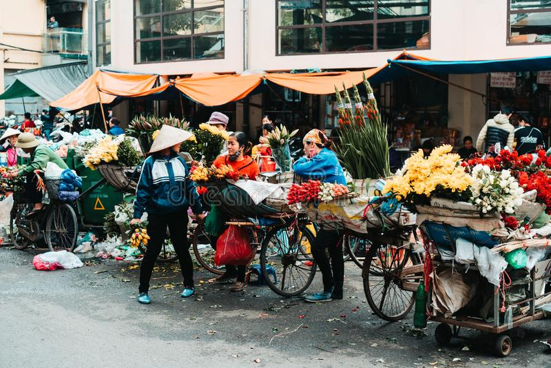 Hanoi, Vietnam, 12.20.18: Life in the street in Hanoi. Vendors try to sell their goods in the busy streets of Hanoi royalty free stock images