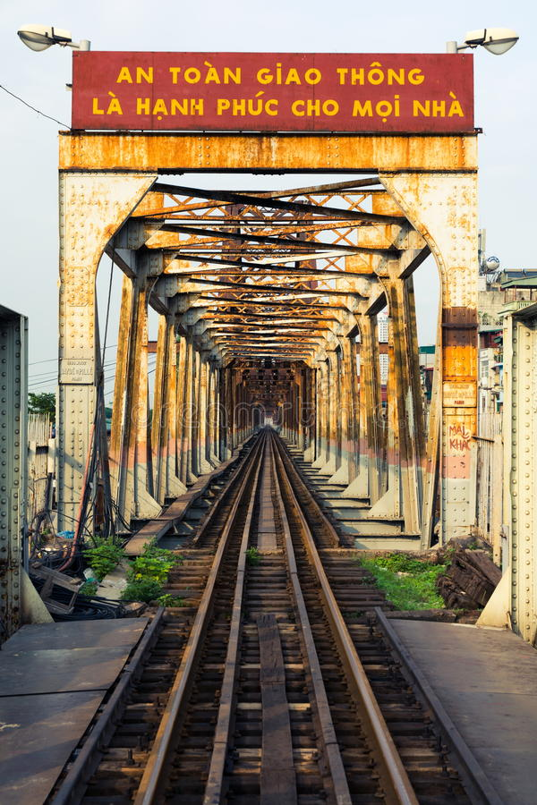 HANOI, VIETNAM - MAY 24, 2017: Hanoi Long Bien bridge with train. Rail which connects two parts of the city across the Red river royalty free stock photo