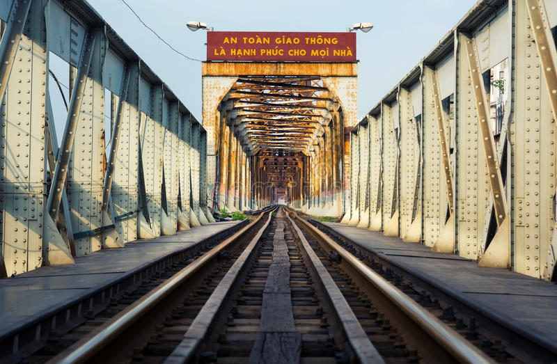 HANOI, VIETNAM - MAY 24, 2017: Hanoi Long Bien bridge with train. Rail which connects two parts of the city across the Red river stock photo