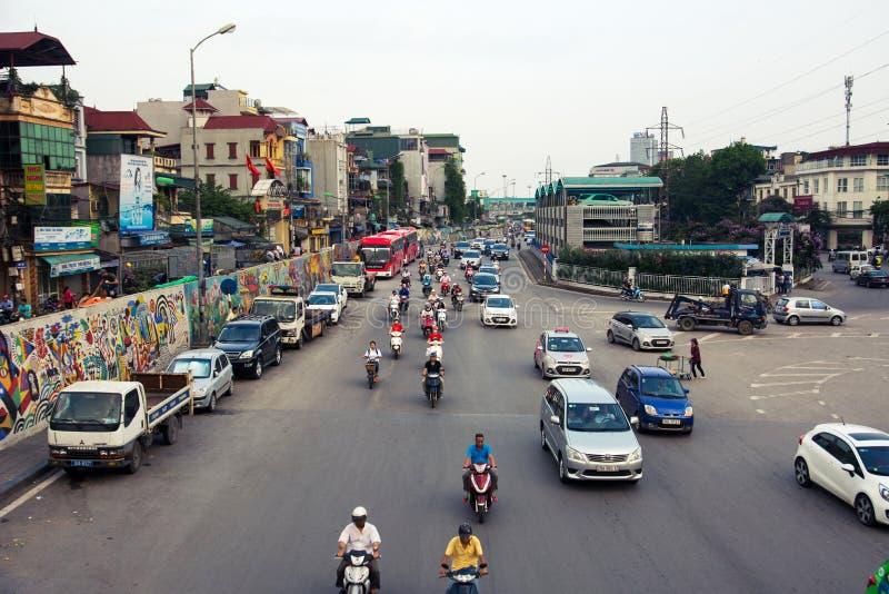 HANOI, VIETNAM - MAY 24, 2017: People on motorbikes on the Hanoi. Ceramic mural painted road shot from the Long Bien bridge stock photo