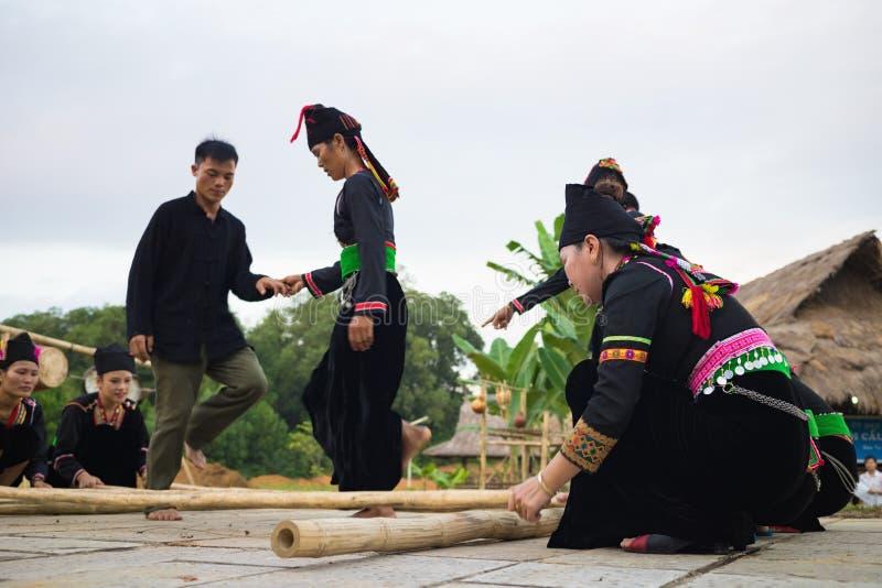Hanoi, Vietnam - Nov 15, 2015: Ethnic minority people perform traditional dance praying for rain in Village of Vietnamese ethnic g royalty free stock image