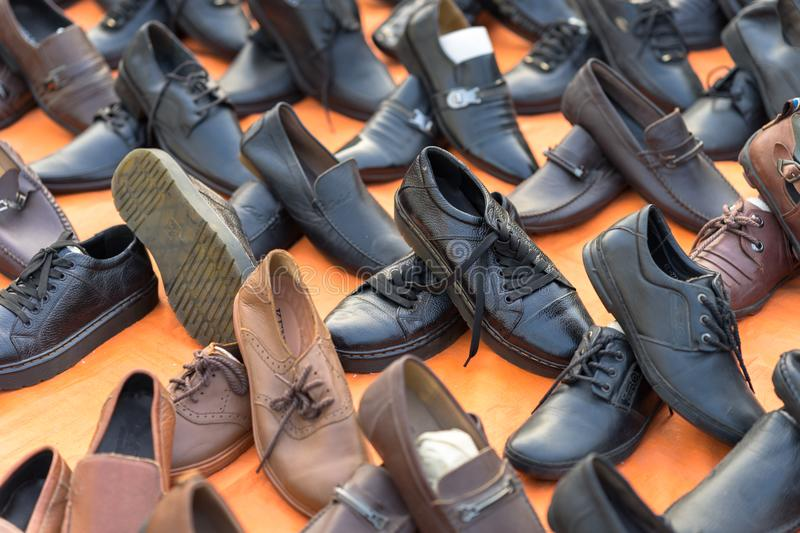 Hanoi, Vietnam - Oct 11, 2016: : Various type of cheap shoes for sale on Hanoi street stock photo