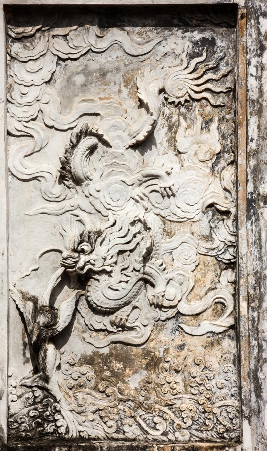 Beautiful View of Wall Carvings Art of Temple of Literature Van Mieu in Vietnamese, it known as Temple of Confucius in Hanoi. royalty free stock images