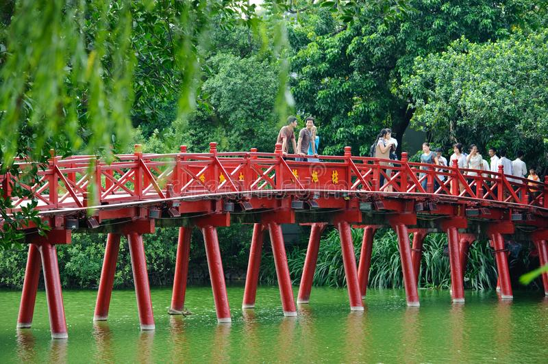 Hanoi, Vietnam - October 14, 2010 : Hanoi red bridge. The wooden red painted bridge over the Hoan Kiem Lake connects the shore and stock image