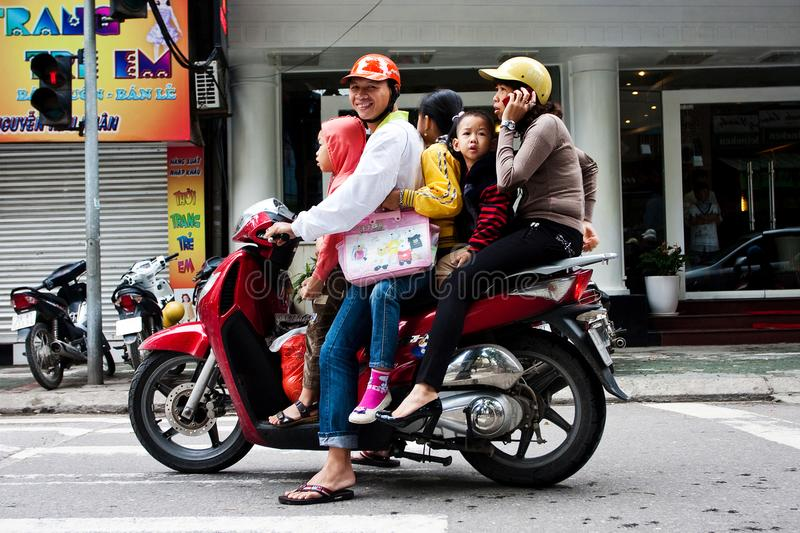 Hanoi, Vietnam - OCTOBER 29, 2011: Parents and three children on one moped. Family transport. royalty free stock photography