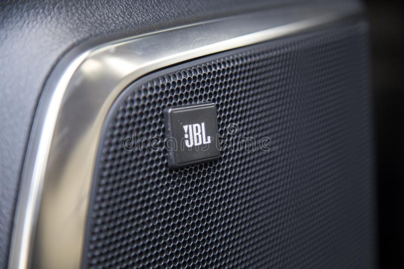 Logo of JBL on the door of a car front stock photography