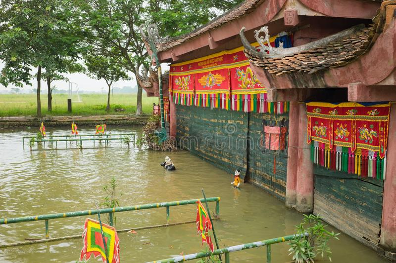 Hanoi, Vietnam - Sep 20, 2015: Common Vietnamese water puppetry state in Dao Thuc village.  royalty free stock photo