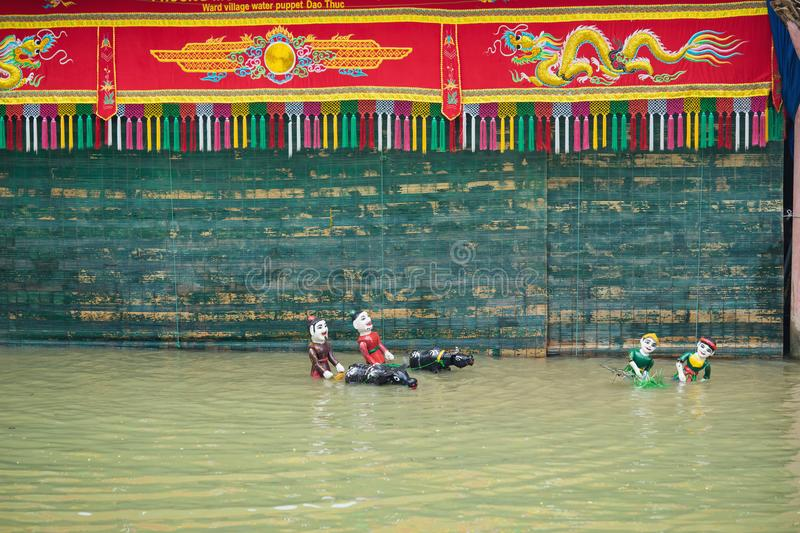 Hanoi, Vietnam - Sep 20, 2015: Common Vietnamese water puppetry state in Dao Thuc village.  royalty free stock image