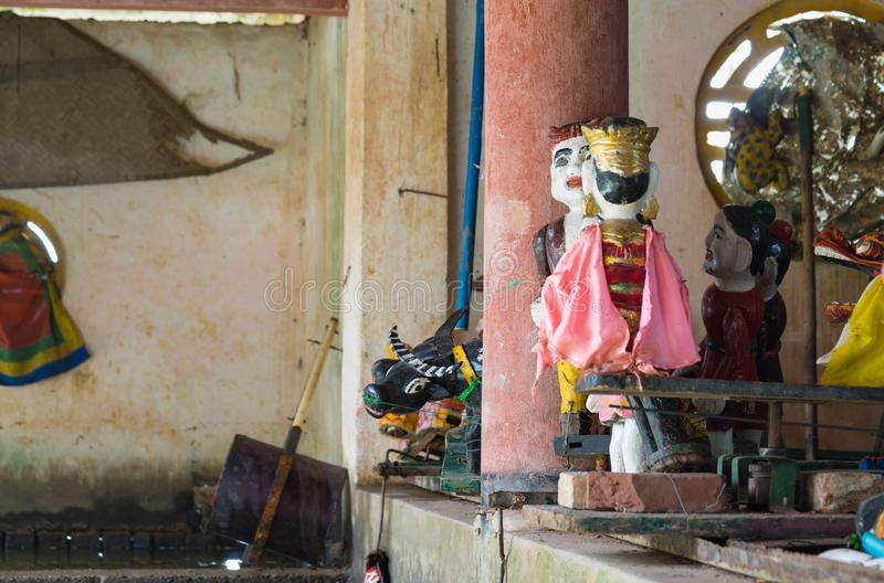 Hanoi, Vietnam - Sep 20, 2015: Common Vietnamese water puppets behind puppetry state. The control room is dark to hide puppeteers. And instruments royalty free stock photo