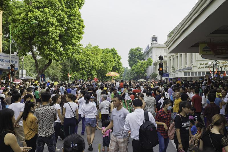 Hanoi, Vietnam - Sep 2, 2015: Crowded people on intersection by Hoan Kiem lake watching military parade on National Day.  stock photo