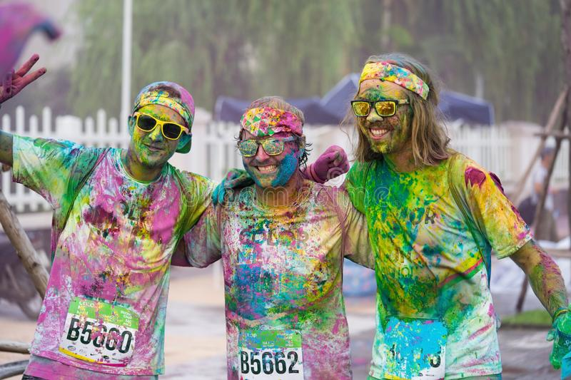 Hanoi, Vietnam - Sep 23, 2015: Group of Caucasians taking selfie photo in public color run event in Hanoi capital city. Hundreds o. F people joined the joyful stock photography