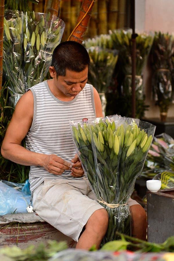 Flower market. HANOI, VIETNAM - SEP 23. 2014: Unidentified man works at the flower market in Hanoi, Vietnam. Flower market in Hanoi is one of the largest flower royalty free stock photography