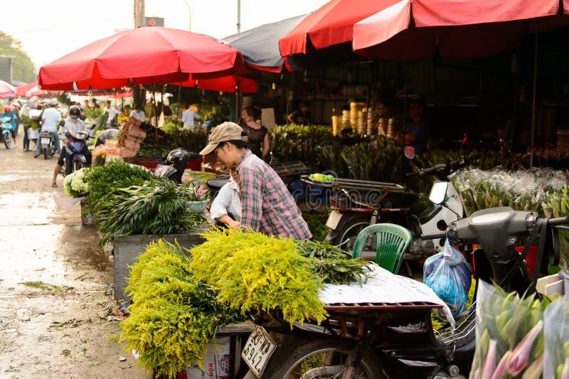 Flower market. HANOI, VIETNAM - SEP 23. 2014: Unidentified man works at the flower market in Hanoi, Vietnam. Flower market in Hanoi is one of the largest flower royalty free stock photos
