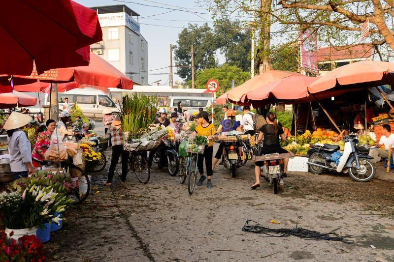 Flower market. HANOI, VIETNAM - SEP 23. 2014: Unidentified Vietnamese people work at the flower market in Hanoi, Vietnam. Flower market in Hanoi is one of the royalty free stock photography