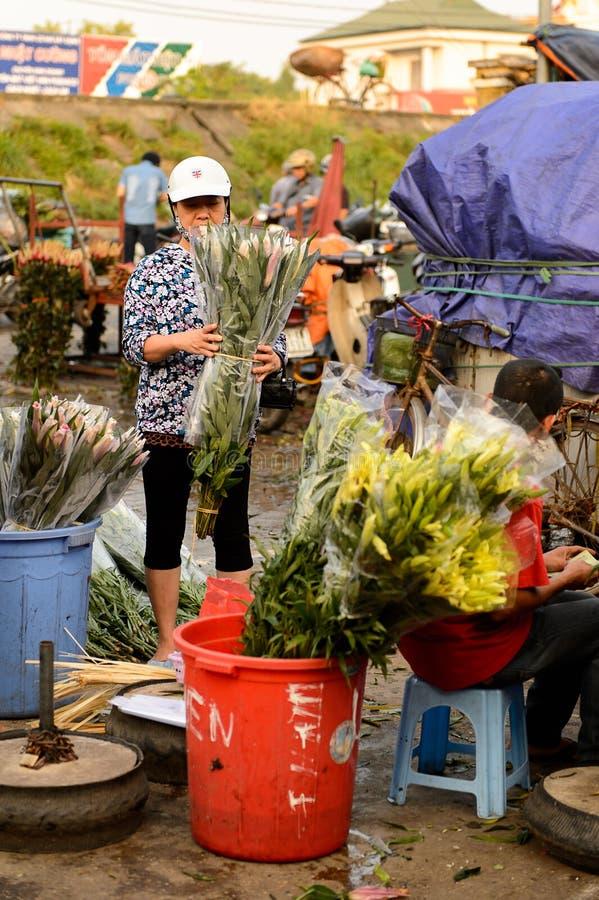 Flower market. HANOI, VIETNAM - SEP 23. 2014: Unidentified Vietnamese people work at the flower market in Hanoi, Vietnam. Flower market in Hanoi is one of the stock photos