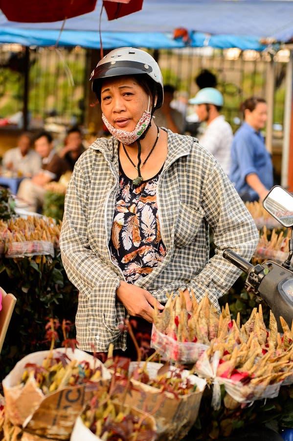 Flower market. HANOI, VIETNAM - SEP 23. 2014: Unidentified woman works at the flower market in Hanoi, Vietnam. Flower market in Hanoi is one of the largest royalty free stock photos