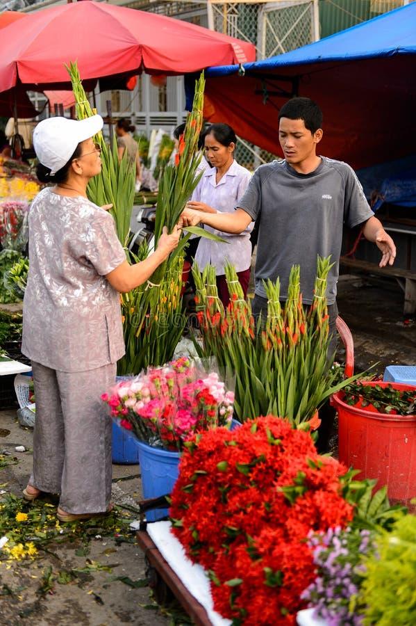 Flower market. HANOI, VIETNAM - SEP 23. 2014: Unidentified woman works at the flower market in Hanoi, Vietnam. Flower market in Hanoi is one of the largest royalty free stock images