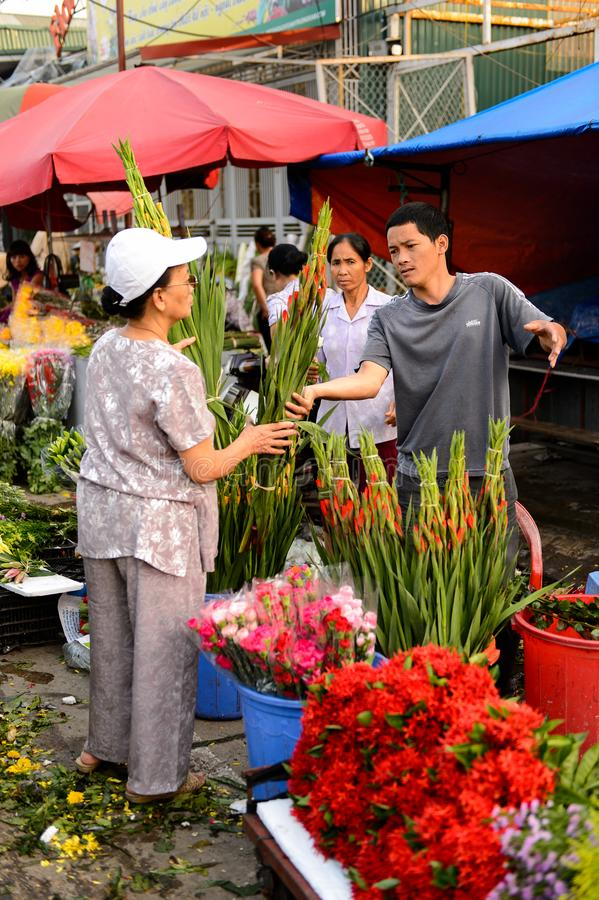 Flower market. HANOI, VIETNAM - SEP 23. 2014: Unidentified woman works at the flower market in Hanoi, Vietnam. Flower market in Hanoi is one of the largest royalty free stock photo