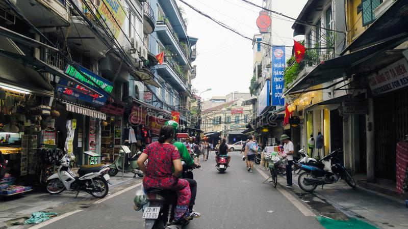 Hanoi - Vietnam. September 01, 2018. busy road with many motorcycles and people . Motorcycle is the most popular mode of transportation in Vietnam royalty free stock image