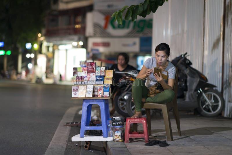 Hanoi, Vietnam - 08 14 2014: A street vendor sells cigarette along a street in Hanoi, Vietnam.  stock images
