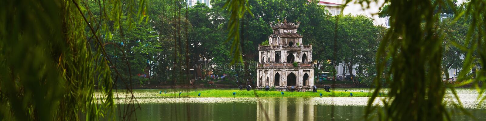 Hanoi, Vietnam. Turtle Tower at Hoan Kiem Lake. In Hanoi, Vietnam. Tree at the foreground, cloudy moody weather stock images