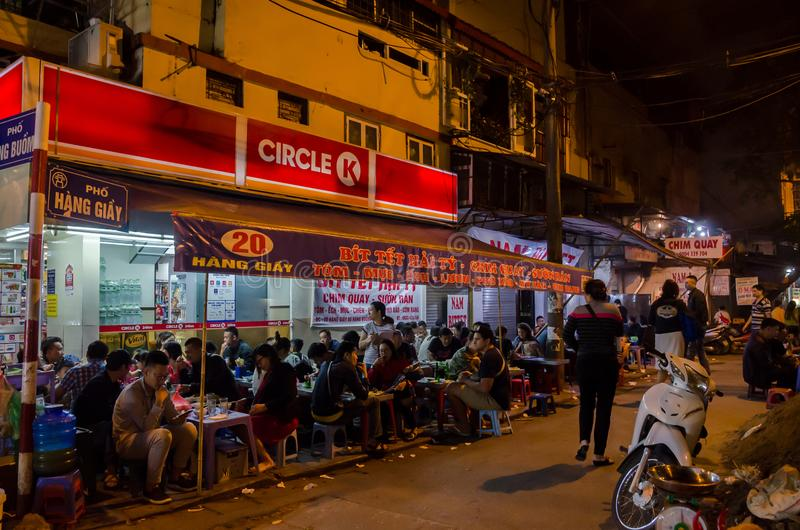 People can seen enjoying their food at the food stalls in Hanoi,Vietnam. Hanoi,Vietname - November 5,2017 - People can seen enjoying their food at the food royalty free stock images