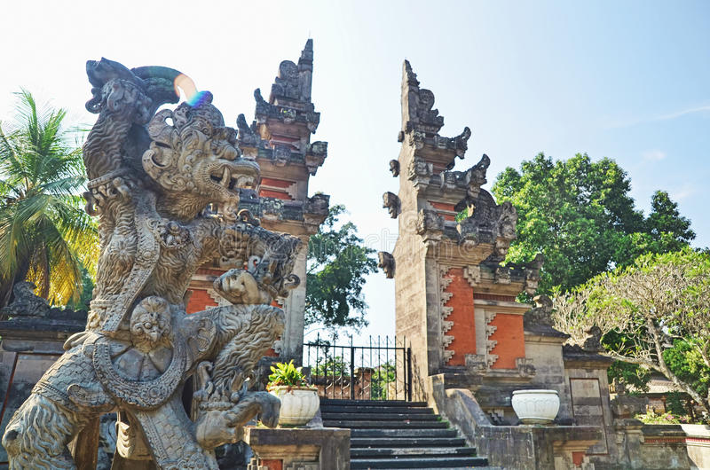 Hanoman Statue in front of Balinese gate. In Indonesia royalty free stock photo